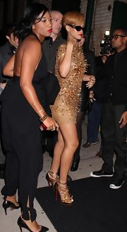 Rihanna completes her spikey ensemble with these sparkle covered, gold, peep toe, ankle booties.