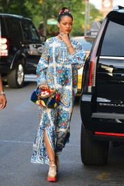 Rihanna rocked clashing prints with this Dolce & Gabbana floral mink purse and printed maxi dress combo.