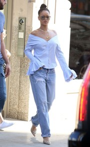 Rihanna contrasted her girly top with ripped boyfriend jeans.