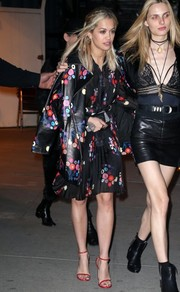 Rita Ora topped off her dress with a matching leather coat.