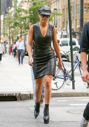 Rita Ora cut a bold figure on the streets of New York City in a plunging, tight-fitting black leather dress.