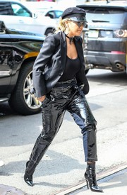 Rita Ora rocked matching patent ankle boots and pants while out in New York City.