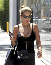 Rita Ora styled her sporty getup with a quilted leather bag by Chanel for a day of shopping.