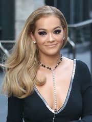 Rita Ora looked oh-so-girly wearing her bouncy waves swept to the side while out in New York City.