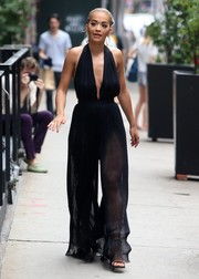 Rita Ora stopped traffic with this sheer, pleated halter jumpsuit by Balmain while out in New York City.