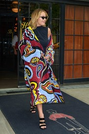 Rita Ora kept the chic coming with a pair of black triple-strap heels by Giuseppe Zanotti.