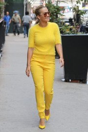 Rita Ora was in a sunshiny mood, pairing her top with high-waisted yellow pants.