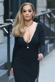 Rita Ora adorned her decolletage with a beaded lariat necklace for a glamorous day out in New York City.