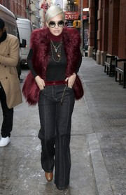 Rita Ora took a stroll in New York City looking retro in flared black jeans by Tommy Hilfiger.