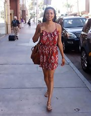 Rochelle Aytes chose a red tribal-print frock for her summery shopping look.