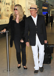 Penny Lancaster arrived with husband Rod Stewart in London wearing a pretty fur coat.