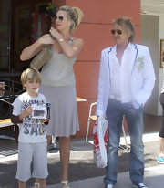 Penny Lancaster was seen in a simple ensemble while shopping with family wearing a tank top and a short skirt.