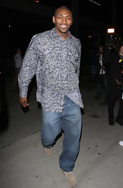 Metta World Peace went for an easy, breezy look with a gray print button-down and jeans.