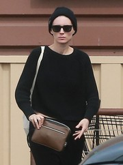 Rooney Mara completed her celeb-on-disguise look with a black beanie.