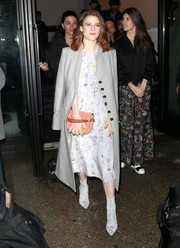 Rose Leslie was seen outside her NY hotel wearing a gray wool coat over a floral frock.