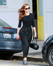 Rose McGowan added polish to her chic monochromatic street style with a black leather barrel tote.