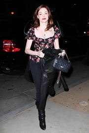 Actress Rose McGowan showed off her dark ensemble with a pair of black jeans and a cute floral top. She completed her look with a classic leather quilted handbag.