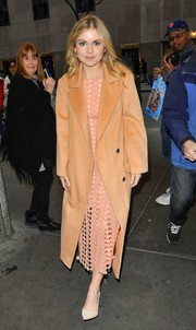 Rose McIver stepped out in New York City looking bright in an orange wool coat layered over a coral lattice dress.