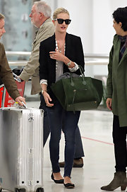 Rosie Huntington-Whiteley threw on a pair of Mercury Seven sunglasses while strolling through the Sydney airport.