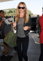 Rosie Huntington-Whiteley looked wickedly chic in a studded black leather jacket by Saint Laurent while making her way through LAX.