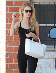 Rosie Huntington-Whiteley was spotted outside her gym carrying a simple yet stylish white leather tote by Victoria Beckham.