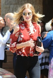 Rosie Huntington-Whiteley looked modern in mirrored round shades by Dita while out in Malibu.