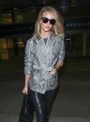 Rosie Huntington-Whiteley stepped out of LAX wearing stylish retro sunnies by Stella McCartney.