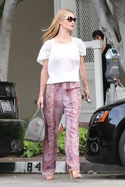 Rosie Huntington-Whiteley chose a bright paisley-print trouser with a straight leg and a fitted waist for her look while running errands in LA.
