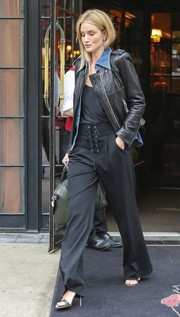 Rosie Huntington-Whitely pulled her flawless look together with a pair of black lace-up pants by A.L.C.