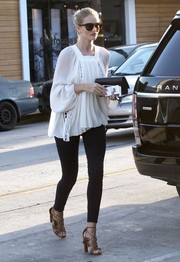 Rosie Huntington-Whiteley was bohemian-chic in a loose white square-neck blouse by Chloe while out running errands.