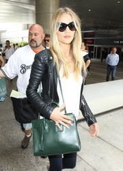 Rosie Huntington-Whiteley hid her eyes behind a pair of oversized Dolce & Gabbana cateye sunglasses as she made her way through LAX.