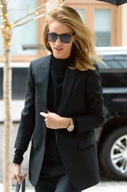 Rosie Huntington-Whiteley accessorized with a luxurious Rolex watch.