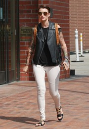 Ruby Rose chose a pair of white skinny jeans to team with her vest.