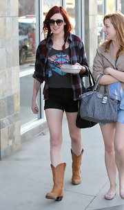Rumer Willis was a modern day cowgirl in black short shorts and cowboy boots.