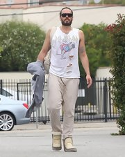 Russell Brand stuck to his rocker look even while heading to yoga when he wore this ripped up graphic print tank.
