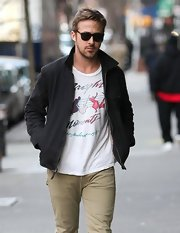 Ryan Gosling strolled through NYC in style with this casual gray zip-up paired with a funky t-shirt.