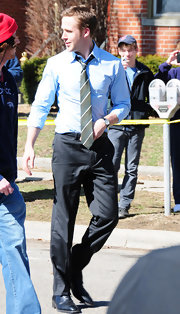 Ryan wore a classic striped tie as he got ready to play a scene as the ambitious campaign manager in 'Ides of March.'