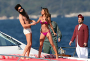 Elisabetta Canalis (in her hot pink bikini) and Sacha Baron Cohen were getting playful on a yacht.