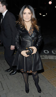 Salma Hayek showed off her killer figure in a flattering flared leather coat.