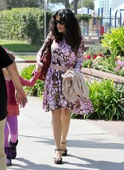 Salma Hayek looked fun and flirty with this floral dress in pink and olive.