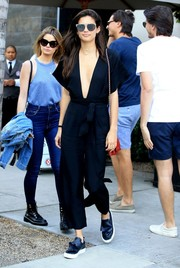 Sara Sampaio was spotted out at Spago rocking a black Faithfull the Brand jumpsuit with a navel-grazing neckline.