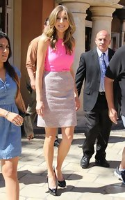 Sarah Chalke opted for a sleek and sophisticated frock with a sleeveless fuchsia top and blush pink tweed skirt.