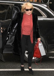 Barbara Walters topped off her casual ensemble with an elegant black fur coat when she attended the Cosmo 100 luncheon.