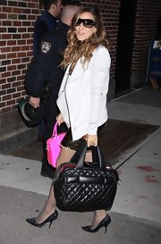 "While heading into to film the ""Late Show with Dvid Letterman"", SJP managed to carry not one but two designer tote bags. In her left hand she showed off a quilted leather ""Cocoon"" bag."