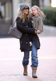 SJP was out and about in slouchy jeans and casual flat boots.