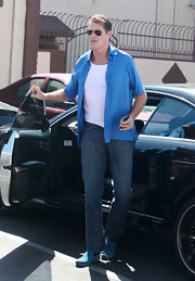 David wears a short sleeve canary blue button-down shirt to the 'Dancing with the Stars' studio.