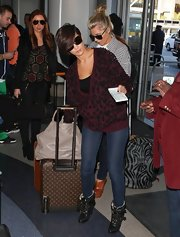 A slouchy leopard-print, burgundy cardigan was a super-comfy and relaxed choice for Frankie Sandford.