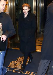 A short-haired Scarlett Johansson was spotted in NYC wearing a black wool trench.