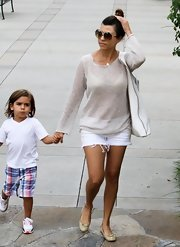 Kourtney Kardashian chose a cream, relaxed-fit sweater to pair with white cutoffs while out with her son.