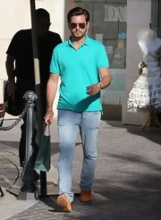 Scott Disick kept his look classic with this turquoise polo.